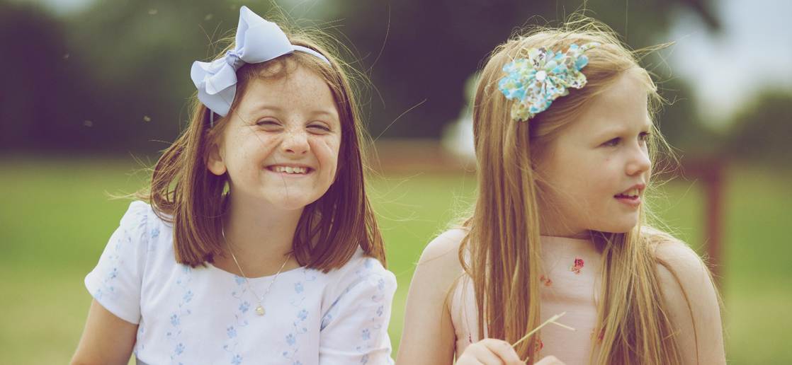 2 young girls smiling - Events at Rainbow Wood Farm, Bath