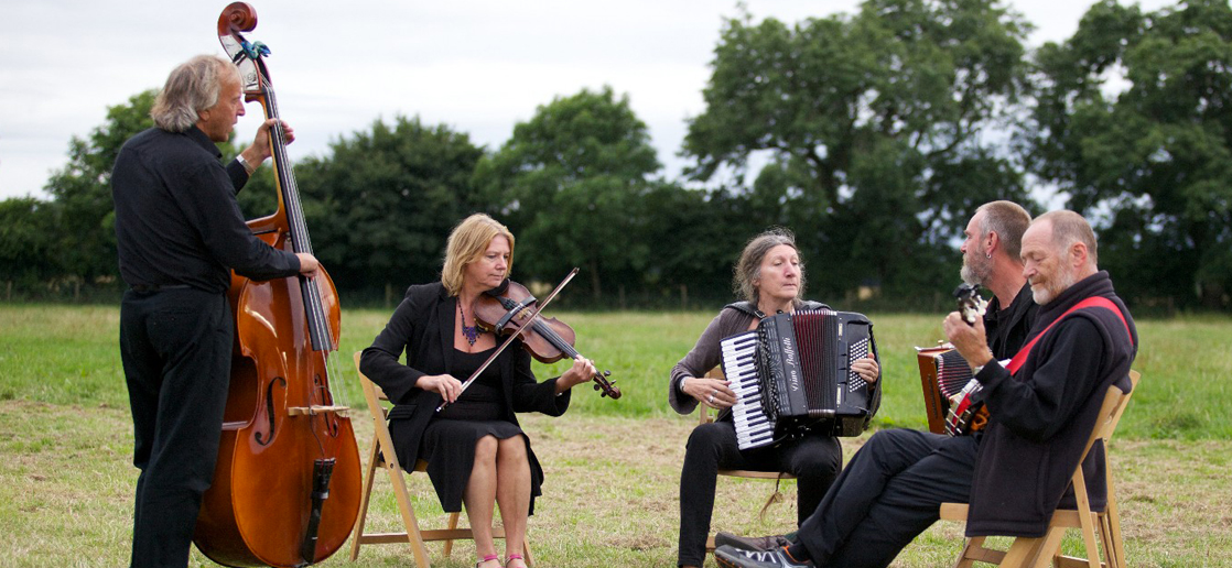 5 piece musicians playing instruments - Events at Rainbow Wood Farm, Bath